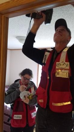 Rick Janelle and Bridget Thomson install alarm