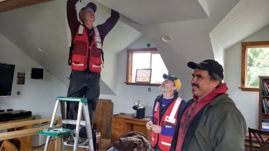 Rick Janelle, Gary Lawton, and Everett Athorp install an alarm